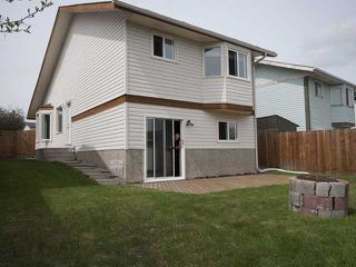 Photo 1: 60 MILLCREST Road SW in CALGARY: Millrise Residential Detached Single Family for sale (Calgary)  : MLS®# C3613674