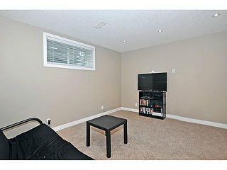 Photo 15: 629 MORNINGSIDE Parkway SW: Airdrie House for sale : MLS®# C3654264
