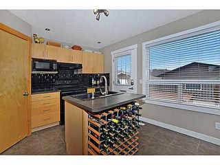 Photo 8: 629 MORNINGSIDE Parkway SW: Airdrie House for sale : MLS®# C3654264