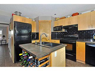 Photo 7: 629 MORNINGSIDE Parkway SW: Airdrie House for sale : MLS®# C3654264