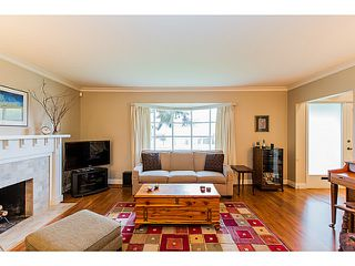Photo 3: 153 HARVEY Street in New Westminster: The Heights NW House for sale : MLS®# V1119422
