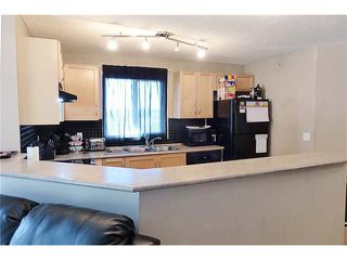 Photo 5: 2441 8 BRIDLECREST Drive SW in Calgary: Bridlewood Condo for sale : MLS®# C4084322