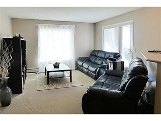 Photo 8: 2441 8 BRIDLECREST Drive SW in Calgary: Bridlewood Condo for sale : MLS®# C4084322