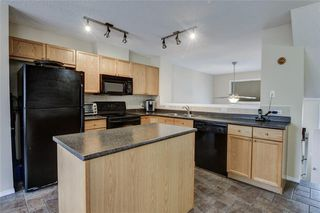 Photo 6: 85 TUSCANY Court NW in Calgary: Tuscany Row/Townhouse for sale : MLS®# C4243968