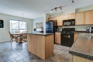 Photo 4: 85 TUSCANY Court NW in Calgary: Tuscany Row/Townhouse for sale : MLS®# C4243968
