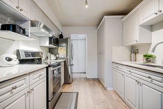 """Photo 2: 68 14123 104 Avenue in Surrey: Whalley Townhouse for sale in """"Hawthorne Park"""" (North Surrey)  : MLS®# R2432033"""