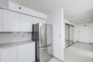 Photo 16: 506 128 2 Avenue SE in Calgary: Chinatown Apartment for sale : MLS®# A1056482