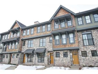Main Photo: 312 ASCOT Circle SW in : Aspen Woods Townhouse for sale (Calgary)  : MLS®# C3601482