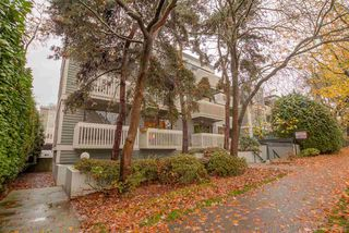 "Photo 1: 107 1545 E 2ND Avenue in Vancouver: Grandview VE Condo for sale in ""TALISHAN WOODS"" (Vancouver East)  : MLS®# R2121835"