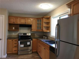 Photo 6: 124 DOVERTHORN Bay SE in Calgary: Dover House for sale : MLS®# C4120719