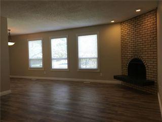 Photo 10: 124 DOVERTHORN Bay SE in Calgary: Dover House for sale : MLS®# C4120719