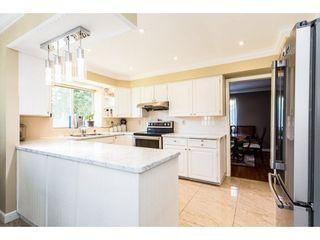 "Photo 6: 9469 156B Street in Surrey: Fleetwood Tynehead House for sale in ""Belair Estates"" : MLS®# R2299575"