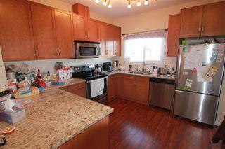 Photo 2: 2512 Pegasus Boulevard in Edmonton: Zone 27 Townhouse for sale : MLS®# E4143228