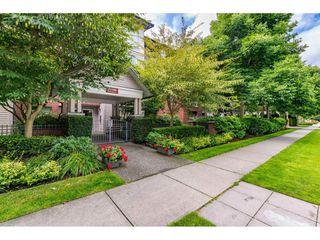 "Photo 1: 207 15188 22 Avenue in Surrey: Sunnyside Park Surrey Condo for sale in ""Muirfield Gardens"" (South Surrey White Rock)  : MLS®# R2397810"