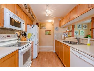 "Photo 9: 207 15188 22 Avenue in Surrey: Sunnyside Park Surrey Condo for sale in ""Muirfield Gardens"" (South Surrey White Rock)  : MLS®# R2397810"