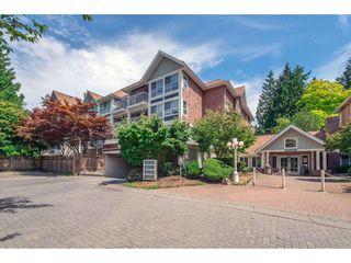 "Photo 2: 110 9650 148 Street in Surrey: Guildford Condo for sale in ""Hartford Woods"" (North Surrey)  : MLS®# R2447474"