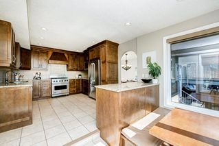 Photo 13: 176 STRATHCONA Road SW in Calgary: Strathcona Park Detached for sale : MLS®# C4301215