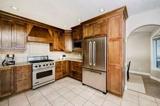 Photo 9: 176 STRATHCONA Road SW in Calgary: Strathcona Park Detached for sale : MLS®# C4301215