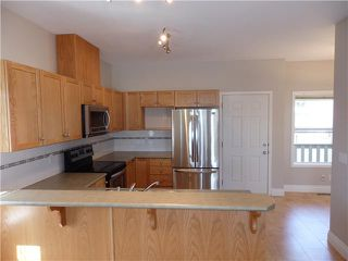 Photo 5: 605 2001 LUXSTONE Boulevard SW: Airdrie Townhouse for sale : MLS®# C3614893