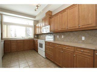 Photo 11: 191 CRAWFORD Drive: Cochrane Condo for sale : MLS®# C4103820