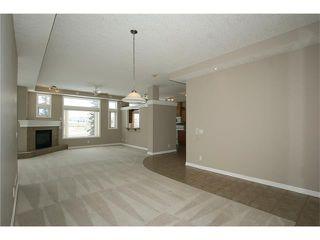 Photo 4: 191 CRAWFORD Drive: Cochrane Condo for sale : MLS®# C4103820