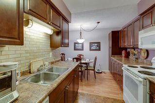 """Photo 14: 408 1210 PACIFIC Street in Coquitlam: North Coquitlam Condo for sale in """"GLENVIEW MANOR"""" : MLS®# R2314767"""