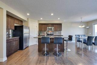 Photo 3: 9655 SIMPSON Place in Edmonton: Zone 14 House Half Duplex for sale : MLS®# E4147944