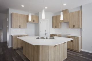 Photo 3: 665 Eagleson Crescent in Edmonton: Zone 57 House Half Duplex for sale : MLS®# E4178462