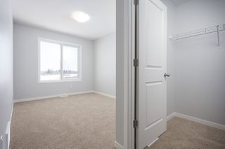 Photo 6: 665 Eagleson Crescent in Edmonton: Zone 57 House Half Duplex for sale : MLS®# E4178462