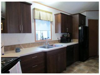 "Photo 3: 8611 79A Street in Fort St. John: Fort St. John - City SE Manufactured Home for sale in ""WINFIELD ESTATES"" (Fort St. John (Zone 60))  : MLS®# N241138"