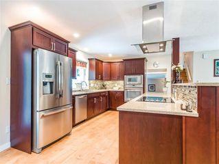 """Photo 3: 1007 PIA Road in Squamish: Garibaldi Highlands House for sale in """"Garibaldi Highlands"""" : MLS®# R2139286"""