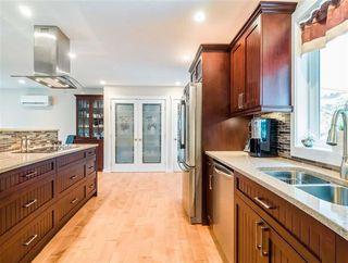 """Photo 4: 1007 PIA Road in Squamish: Garibaldi Highlands House for sale in """"Garibaldi Highlands"""" : MLS®# R2139286"""