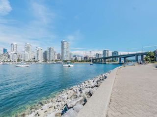 "Photo 2: 116 1859 SPYGLASS Place in Vancouver: False Creek Condo for sale in ""REGATTA"" (Vancouver West)  : MLS®# R2181553"