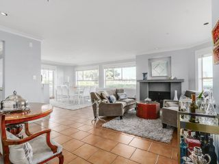 "Photo 8: 116 1859 SPYGLASS Place in Vancouver: False Creek Condo for sale in ""REGATTA"" (Vancouver West)  : MLS®# R2181553"