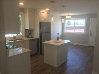 Photo 5: 6808 43 Avenue NE in Calgary: Temple House for sale : MLS®# C4125844