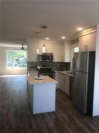 Photo 4: 6808 43 Avenue NE in Calgary: Temple House for sale : MLS®# C4125844