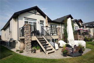 Photo 3: 314 CRYSTAL GREEN Rise: Okotoks House for sale : MLS®# C4138199