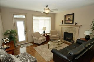 Photo 9: 314 CRYSTAL GREEN Rise: Okotoks House for sale : MLS®# C4138199