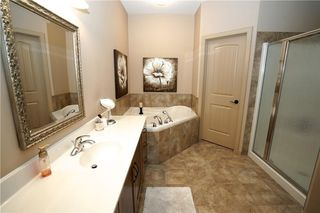 Photo 11: 314 CRYSTAL GREEN Rise: Okotoks House for sale : MLS®# C4138199
