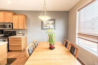 Photo 10: 403 CIMARRON Boulevard: Okotoks House for sale : MLS®# C4170215