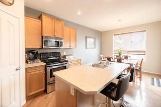 Photo 11: 403 CIMARRON Boulevard: Okotoks House for sale : MLS®# C4170215