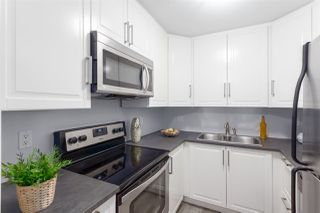 """Photo 8: 102 1950 E 11TH Avenue in Vancouver: Grandview VE Condo for sale in """"LAKEVIEW PLACE"""" (Vancouver East)  : MLS®# R2265085"""