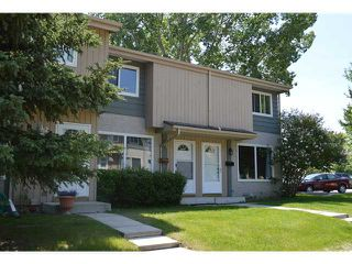 Photo 1: 202 999 CANYON MEADOWS Drive SW in CALGARY: Canyon Meadows Townhouse for sale (Calgary)  : MLS®# C3620666