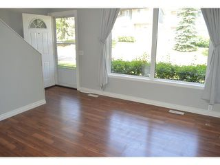 Photo 2: 202 999 CANYON MEADOWS Drive SW in CALGARY: Canyon Meadows Townhouse for sale (Calgary)  : MLS®# C3620666