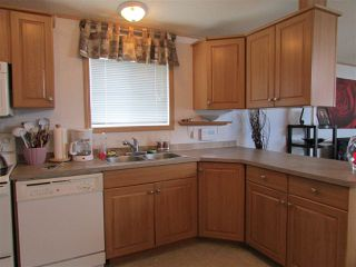 """Photo 4: 49 9203 82 Street in Fort St. John: Fort St. John - City SE Manufactured Home for sale in """"THE COURTYARD"""" (Fort St. John (Zone 60))  : MLS®# R2074488"""