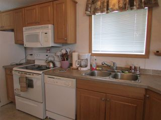 """Photo 3: 49 9203 82 Street in Fort St. John: Fort St. John - City SE Manufactured Home for sale in """"THE COURTYARD"""" (Fort St. John (Zone 60))  : MLS®# R2074488"""