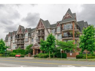 "Photo 1: 218 17769 57 Avenue in Surrey: Cloverdale BC Condo for sale in ""Clover Downs Estates"" (Cloverdale)  : MLS®# R2177981"