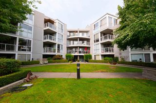 "Photo 1: 207 8460 JELLICOE Street in Vancouver: Fraserview VE Condo for sale in ""Boardwalk"" (Vancouver East)  : MLS®# R2297100"