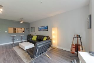 "Photo 4: 207 8460 JELLICOE Street in Vancouver: Fraserview VE Condo for sale in ""Boardwalk"" (Vancouver East)  : MLS®# R2297100"