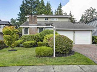 """Photo 1: 916 MERRITT Street in Coquitlam: Harbour Chines House for sale in """"HARBOUR CHINES"""" : MLS®# R2305133"""